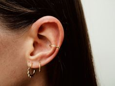 Tiny hoop earrings perfect for any occasion. Minimalistic, delicate yet with an edge! Very comfortable for everyday wear. • Earrings measure: 1.5cm •
