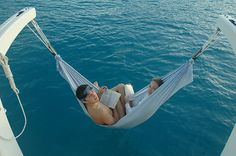 reading on hammocks with boy over ocean=bliss