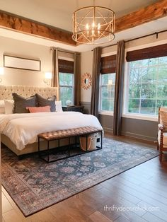 Colorful master bedroom refresh {with one change!} Cozy Bedroom, Master Bedroom, Bedroom Ideas, Dark Grey Walls, Thrifty Decor Chick, Wood Beams, Wood Accents, King Beds, Traditional Rugs