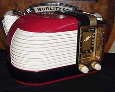 Beautiful Machine Age Bakelite radio finished in Rich Red and Black with Cream grill and Real Brass Dial Escutcheon. This radio is a fine example of the classic designs of the era and features four pushbutton station preset buttons on the top of the radio. A great addition to your collection!    $995.00