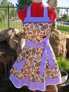Aprons / Retro Apron / Womens, Handmade, Southern Belle / Scarlet Chic Sassy Apron / Matryoshka Dolls. $36.95, via Etsy.