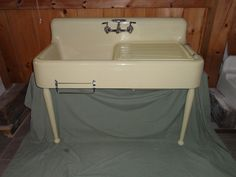 yellow cast iron farmhouse sink with legs (ebay, $1800...ugh)