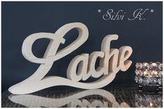 erhältlich hier: https://de.dawanda.com/product/111210619-schriftzug-lache-naturbelassen-l-325-cm Silvi K., Holzschriftzug,  Handarbeit aus Holz, Lebe, Liebe, Lache