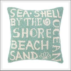 Beach Words pillow. Sea Shell. By the Shore. Beach. Sand. Ocean. Show your love of the shore with our beach word association hook pillow.  Blue green color with ivory words create a casual beach cottage style.