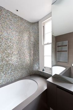 Awesome wall tiles by the bathtub