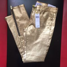 BCBGENERATION Gold Skinny Jeans Never worn. Still with tags. With zippers on bottoms BCBGeneration Jeans Skinny