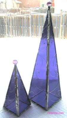 These stained glass trees will brighten any room- they look great in the middle of a table or on a mantel. All trees have a glass plate on the back to allow for a candle or tea light to burn. The...