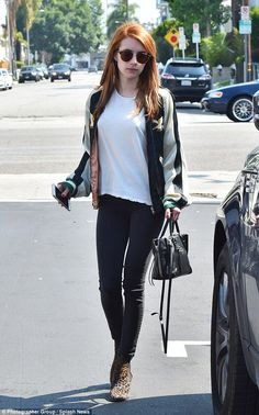 Stylish: Actress Emma Roberts wore a green-and-white bomber jacket as she stopped for lunch in Los Angeles on Tuesday