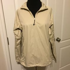 Nike Golf Clima-Fit half zip jacket size small Drawstring bottom, deep side zip pockets, lightweight jacket, sleeves zip off to become short sleeve as you can see in second picture. Looks brand new! Nike Jackets & Coats