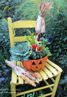 Autumn chair & solidago (Garden of Len & Barb Rosen)