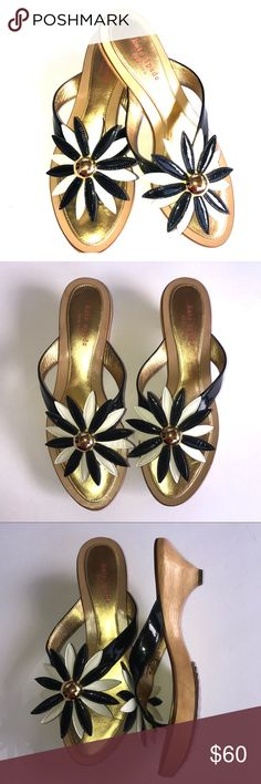 """Kate Spade Sandal, kitten heel, Size 9 in EUC These beautiful Kate Spade wooden kitten heels are in excellent pre-owned condition. Heel height is 2"""". They are a size 9 and show minimal wear, no flaws. Gold, blue and white, very cute. kate spade Shoes Sandals"""