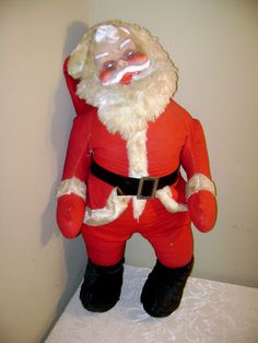No one puts Santa in a corner. I believe he is being propped up, perhaps due to excessive substance use?