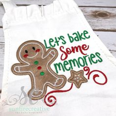 """This apron is adorable for your favorite little helpers in the kitchen or even perfect for a Christmas photo shoot! It features an adorable appliqued gingerbread man with an embroidered saying of your choice! Apron Measurements - Plain is 15""""W x 20""""L Ruffle is 20x14 Velcro's at the neck and ties at the waist"""
