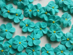 Small teal royal icing flowers  Handmade by SweetSarahsBoutique