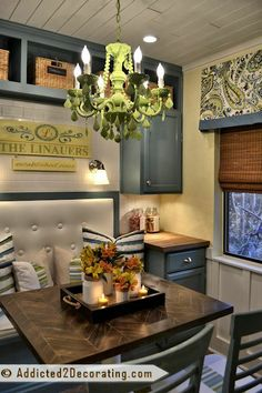 use this feel to do the black and white curtains in breakfast nook condo kitchen decorating