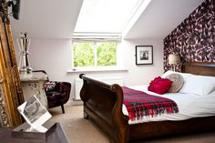 The Cartford Inn has entered a beautiful guestroom full of rich tartan touches and antique furniture.