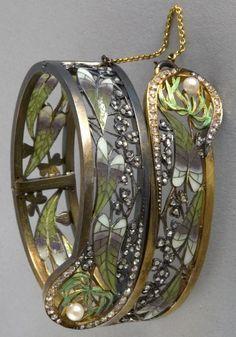 An Art Nouveau bracelet, by Lluis Masriera, circa 1905. An articulated bracelet composed