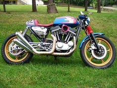 """""""RACESTAR"""" - Harley Davidson Cafe Racer  All I know about this bike is it is a modified 1992 Sportster 883. Built in May 2012, it has a completely revised engine including 1200 kit, Mikuni carburetor, swing arm truss, twin front disc and it was painted by """"FUN BIKE 32""""    Make a small hugger and a few other mods to make it legal in Australia and that is one bike I'd love to build and more importantly ride!    I think this bike is for sale at 16,500€ (around AU$20,000)  L"""