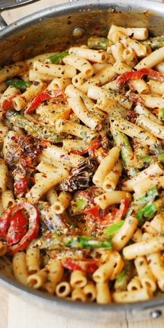 Penne Pasta, Bell Peppers, and Asparagus in a Creamy Sun-Dried Tomato Sauce, with basil and crushed red pepper. The vegetables taste so good with all the spices, pasta, and the flavorful creamy sauce in this Italian pasta dinner! @juliasalbum