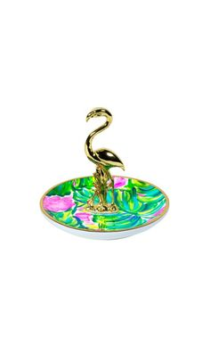 This ring holder features our favorite prints and contains a gold critter to store your rings.