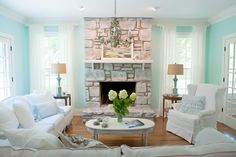 Isn't the fireplace GORGEOUS now?  The new wall color is Benjamin Moore's Iced Green, which plays into the coastal palette throughout the home.