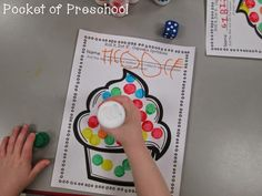 Cupcake Sprinkles Dot It.  Roll a dice and dot the number you rolled!  A fun counting game.  Pocket of Preschool