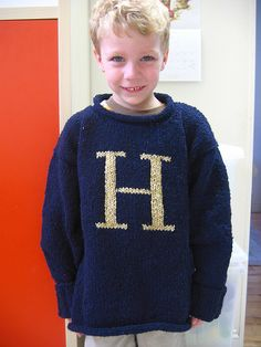 Weasley sweaters for everyone! Just like the sweaters Mrs. Weasley made for her kids and Harry for Christmas in the first movie, this simple oversized sweater is knit in a tweedy yarn with an initial on the front. The sweater is a basic, drop-shoulder style, with sleeves knit down from the body of the sweater so there's minimal seaming. And because it's knit at such a comfortable gauge and oversized, this project is great for a beginner charming up a sweater for the first time. The…