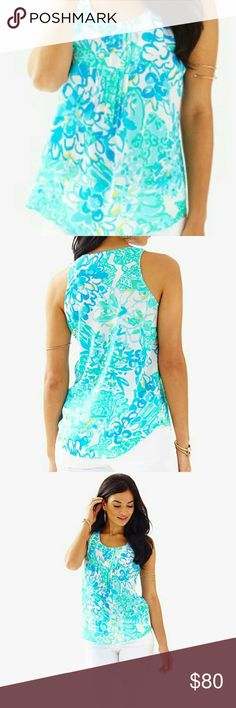 DAHLIA TOP The Dahlia Top is a sleeveless silk top in gorgeous spring prints. This new top has stitch and release pleats and a scoop neck. We love this top with white denim and wedges.? Sleeveless Top With Stitch And Release Pleat Detail. 100% Silk. Dry Clean Only.  Lilly Pulitzer, Lilly Dahlia Top In Breakwater Blue Lolita, Lilly Pulitzer Style 19690 Lilly Pulitzer Tops Tank Tops