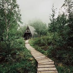 wood plank trail leading to a-frame cabin via daniel taipale. / sfgirlbybay