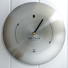 A contemporary, minimal design makes this stainless steel tide clock ideal for any secluded retreat. High Tide Low Tide, Tide Clock, Time And Tide, Minimal Design, Contemporary Design, Coffee Cups, Airstream, Wall Clocks, Eco Friendly