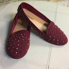 Burgundy stud flats Super cute ballet flats with studs. Only worn a couple of times. Flaws are featured in pics. Otherwise, in pretty good condition. Shoe Dazzle Shoes Flats & Loafers