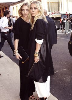 Mary-Kate and Ashley Olsen in black and white.