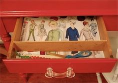 Sewing Table: detail of the sewing table drawer, lined with copies of vintage dress patterns