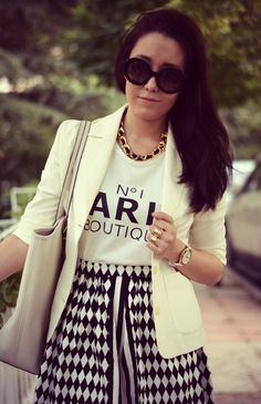 I like the graphic patterns used in her shirt. Luxurious and goes well with the typography.