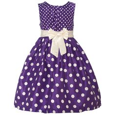 Trendy dress with a fitted bodice, a voluminous skirt and a purple pop of color from designer Mia Juliana. The dress features little ivory polka dots on the sleeveless bodice and bigger ones on the flared skirt bringing out a cute visual effect. Ivory rib