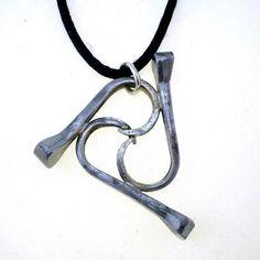 Items similar to Horse Shoe Nail Triskelion Triple Wave Equestrian Pendant on Etsy Horseshoe Nail Art, Horseshoe Crafts, Horseshoe Ideas, Horse Shoe Nails, Nail Jewelry, Jewlery, Rustic Jewelry, Handmade Jewelry, Horse Jewelry