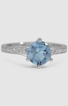 A round blue aquamarine makes this Sapphire Hudson Ring in white gold sensational.