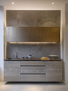 Roundhouse Urbo bespoke kitchen cabinets in Driftwood with wall cabinet in Burnished Bronze finish