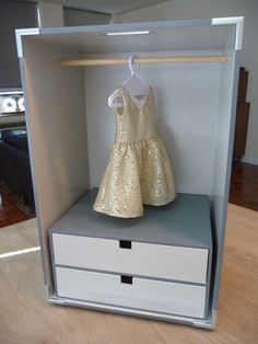 """Doll closet.  Wonder if my husband can make something like this with a bit thinner dowel, and I could make a cute curtain """"door"""" for American Girl doll?"""