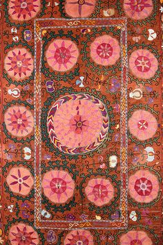 Suzani is a tribal textile with roots from Persia and central Asian countries. It gets its name from the Persian word for needle.