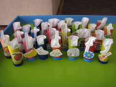 Stand Up Alphabet using Cardboard Tubes and Bottle Tops - Free Printable