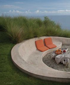 outdoor firepit and concrete bench, outdoor seating, built in seating, seat wall