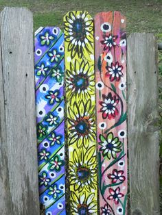 In April 2011, the south experienced so many storms. We had an abundance of fence boards laying on the side of our streets. I painted fence boards in acrylics and used them as garden decor. Upcycled! Sandra's Art Works