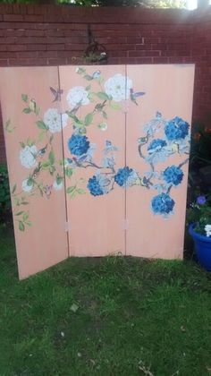 Decoupage side of screen that I made from 3 wardrobe doors...other side is very shabby chic so I can use it either way.