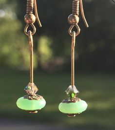 Hey, I found this really awesome Etsy listing at https://www.etsy.com/il-en/listing/534256165/green-sea-glass-dangle-earrings-vintage