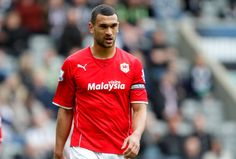 Cardiff City's Steven Caulker looks dejected after his team are relegated during the Barclays Premier League match between Newcastle United and Cardiff City at St. James'  Park on May 03, 2014  in Newcastle upon Tyne, England.