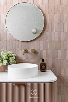 This has to be the pink tiled bathroom of our dreams. We love the round bathroom mirror, pink tiles and gold tapwear. Kitchen Island Bench, Art Deco Home, Basin Sink, Occasional Chairs, Bathroom Inspiration, Bathroom Ideas, Round Bathroom Mirror, Interiores Design, Bathroom Interior
