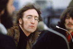 John Lennon with Paul & George.