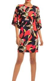 Shadow brook Dress - You're fully equipped for day to night dressing with the Shadowbrook Dress. In a rich and colorful collage floral print, this matte jersey dress features flutter sleeves and a sleek tunic sheath silhouette. Pull over styling. Dry clean.