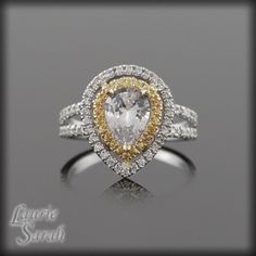 Pear Cut White Sapphire Engagement Ring with Yellow Sapphire and Diamond Double Halo - LS1543. $2,853.15, via Etsy.